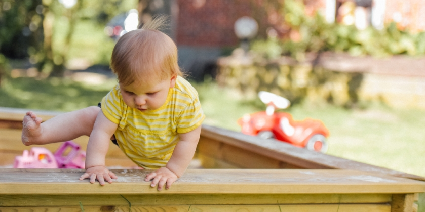 toddler full of energy - escaping sandbox